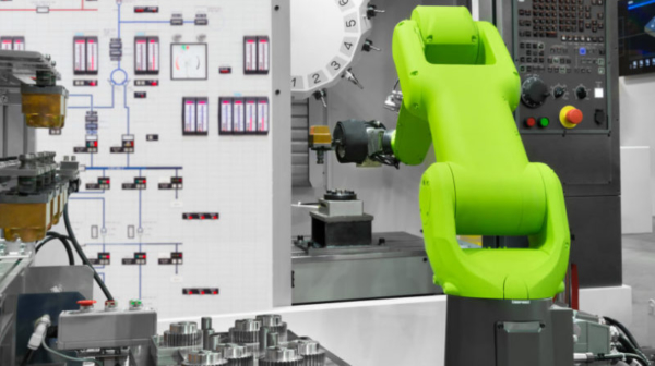 Automation robotic industry picking automotive parts with CNC machine in manufacturing